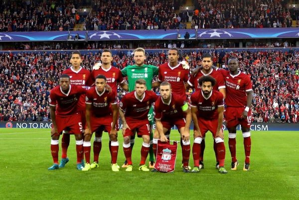 Liverpool bounce back with easy win at Huddersfield